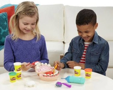 Children playing with Play-Doh Doctor Drill and Fill